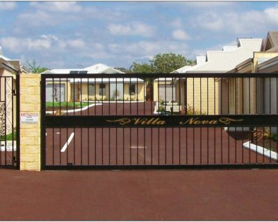Sliding gate with side access pedestrian gate
