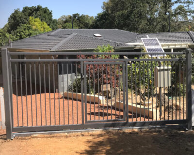 Sliding gate with inset pedestrian gate, powder coated.