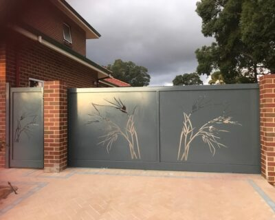 Sliding gate with laser cut panels and matching side pedestrian access gate